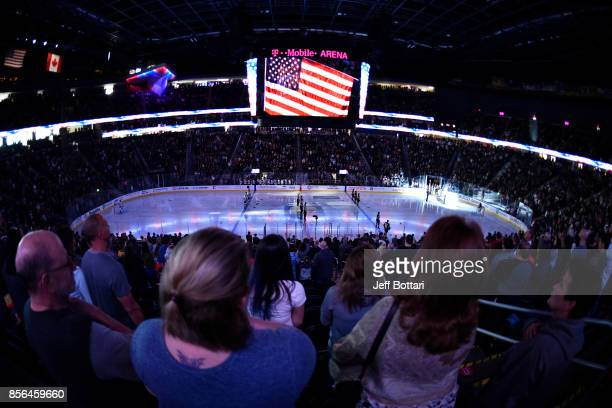 Fans stand for the National Anthem prior to the game between the Vegas Golden Knights and the San Jose Sharks at TMobile Arena on October 1 2017 in...