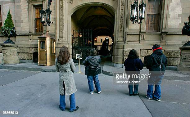 Fans stand in front of the Dakota apartments where John Lennon was murdered December 7 2005 next to Central Park in New York City Lennon was killed...