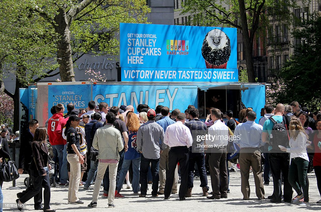 Fans stand in line to view the Stanley Cup and NHL themed cupcakes during a 2013 Stanley Cup Playoffs kickoff event at Madison Square Park on April 30, 2013 in New York City. The NHL, NBC Sports and Crumbs Bake Shop hosted the event to celebrate the start of the 2013 Stanley Cup Playoffs.