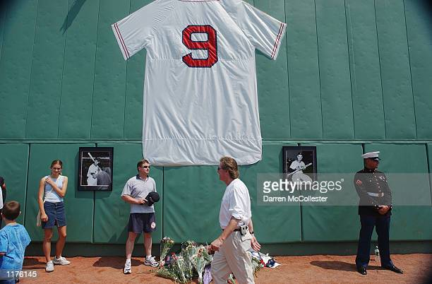 Fans stand near a replica of Ted Williams jersey during 'Ted Williams A Celebration of an American Hero' day on July 22 2002 at Fenway Park in Boston...