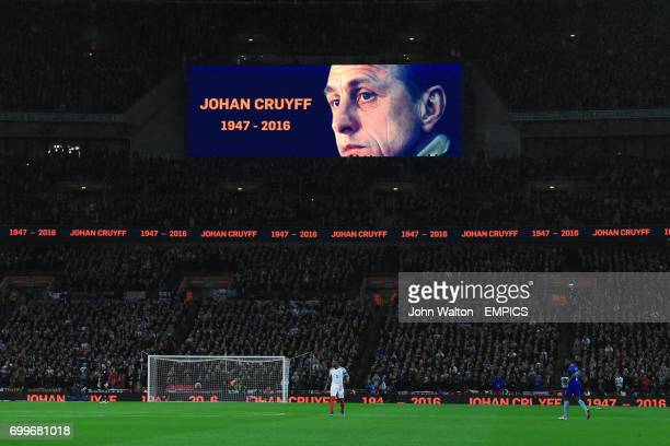 Fans stand to applaud the late Johan Cruyff in the 14th minute of play during the International Friendly match at Wembley Stadium London