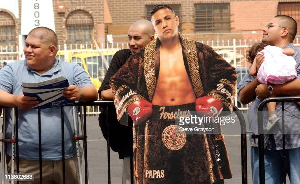 Fans stand with a life sized poster of boxer Fernando Vargas
