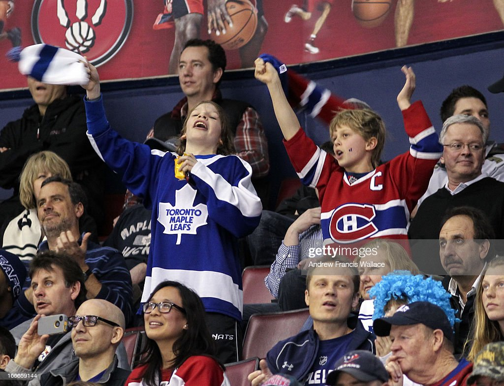 Fans support their team during the Toronto Maple Leafs and Montreal Canadiens NHL game at the Air Canada Centre in Toronto, April 13, 2013. The Maple Leafs defeated the Canadiens 5-1.