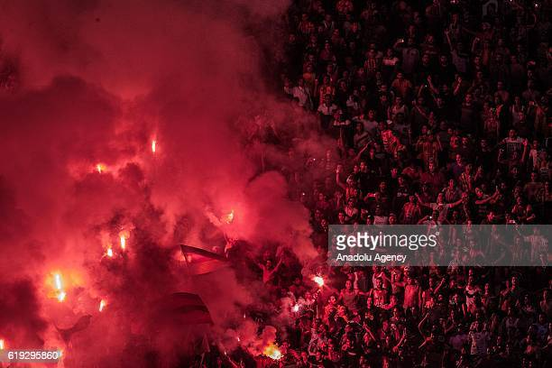 Fans support their team during the Tunisian Professional League 1 football match between Esperance Sportive and Club Africain at the Rades Stadium in...