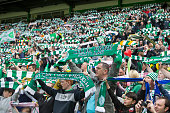 Fans support there Celtic team at the Scottish Premiership Match between Celtic and Inverness Caley Thistle at Celtic Park on May 24 2015 in Glasgow...