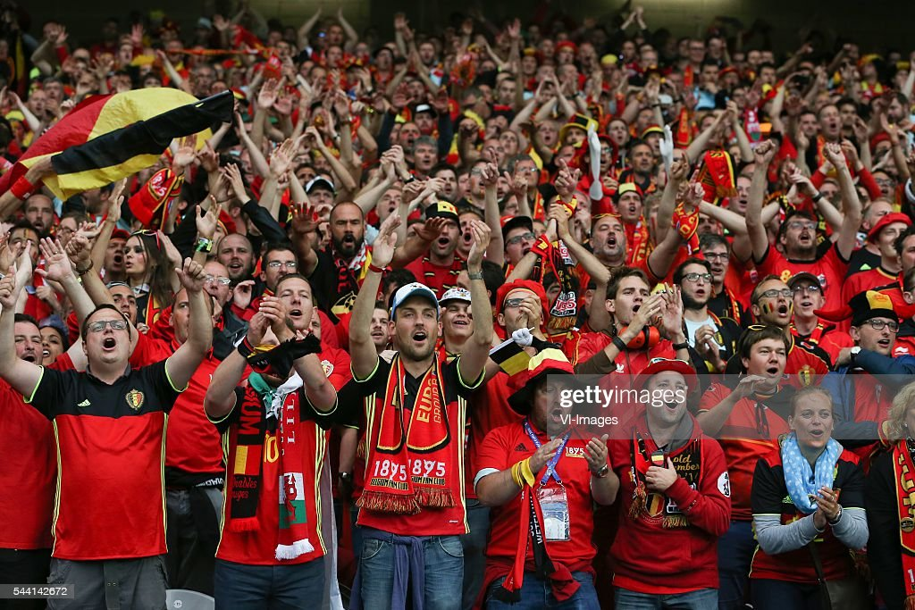 fans, supporters, stand, belgium, celebrate during the UEFA EURO 2016 quarter final match between Wales and Belgium on July 2, 2016 at the Stade Pierre Mauroy in Lille, France.