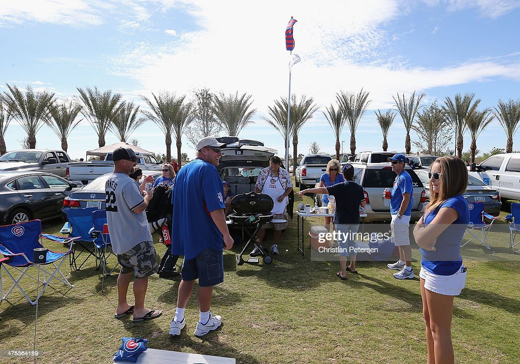 Fans tailgate before the spring training game between the Chicago Cubs and the Arizona Diamondbacks at Cubs Park on February 27 2014 in Mesa Arizona