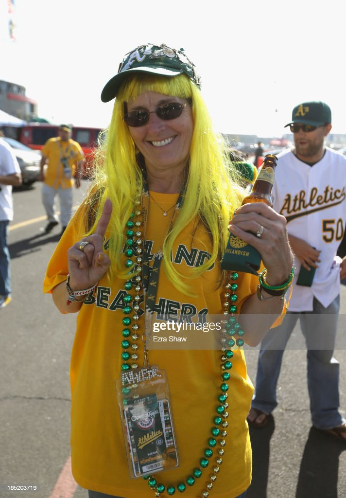 Fans tailgate before the start of the Oakland Athletics game against the Seattle Mariners on Opening Day at O.co Coliseum on April 1, 2013 in Oakland, California.