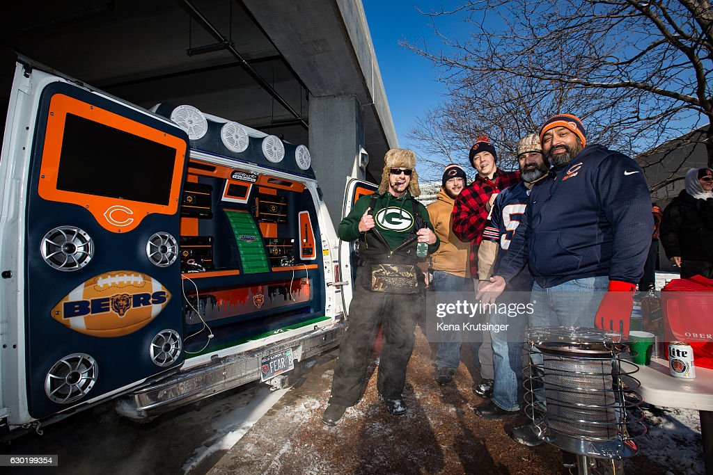 Fans tailgate prior to the game between the Chicago Bears and the Green Bay Packers at Soldier Field on December 18, 2016 in Chicago, Illinois. Today's game is expected to be one of the coldest games ever played at Soldier Field.