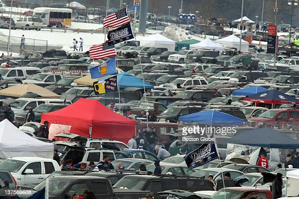 Fans tailgating in the parking lot before the New England Patriots play the Baltimore Ravens in the AFC Championship Game at Gillette Stadium on...
