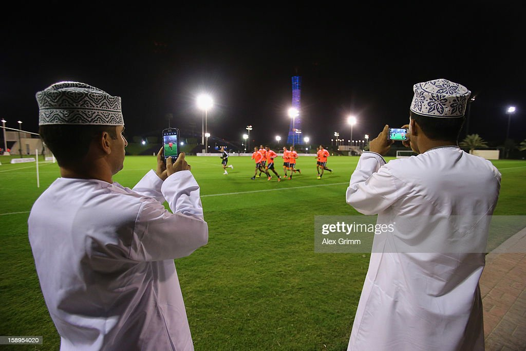 Fans take a picture of the players running during a Bayern Muenchen training session at the ASPIRE Academy for Sports Excellence on January 4, 2013 in Doha, Qatar.