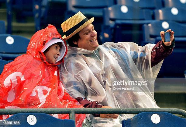 Fans take a selfie in the rain before the game between the Cincinnati Reds and Philadelphia Phillies at Citizens Bank Park on June 2 2015 in...