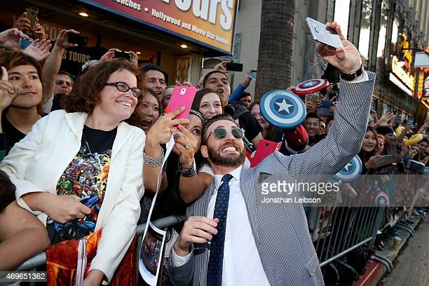 Fans take a selfie with actor Chris Evans using the new Samsung Galaxy S 6 edge at the release of 'Avengers Age Of Ultron' at Dolby Theatre on April...