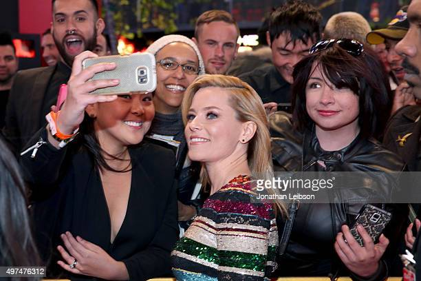 Fans take a Selfie with actress Elizabeth Banks at the premiere of The Hunger Games Mockingjay – Part 2 on November 16 2015 in Los Angeles California