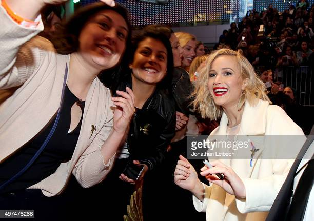 Fans take a Selfie with actress Jennifer Lawrence at the premiere of The Hunger Games Mockingjay – Part 2 on November 16 2015 in Los Angeles...
