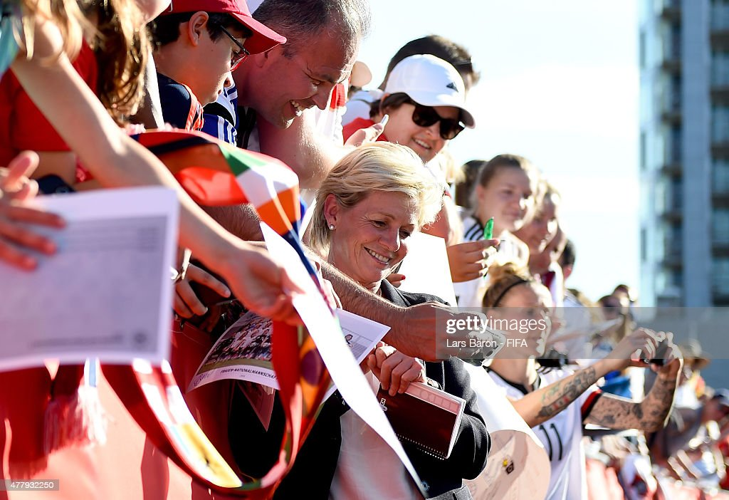 Fans take a selfie with head coach Silvia Neid of Germany after the FIFA Women's World Cup 2015 Round of 16 match between Germany and Sweden at Lansdowne Stadium on June 20, 2015 in Ottawa, Canada.