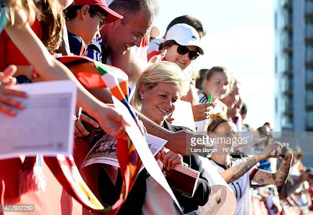 Fans take a selfie with head coach Silvia Neid of Germany after the FIFA Women's World Cup 2015 Round of 16 match between Germany and Sweden at...