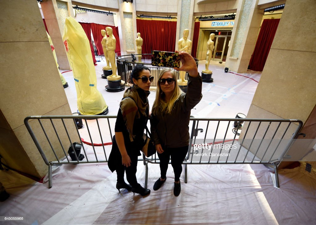 Fans take a selfle with the Oscar statue placed in the rotunda of the Dolby Theater as preparation for the 89th Academy Awards continue at Hollywood and Highland Center on February 24, 2017 in Los Angeles, California.
