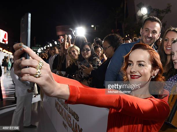 Fans take a Wide Angle Selfie with actress Jena Malone using the new Samsung Galaxy Note 4 at the release of The Hunger Games Mockingjay Part 1 on...