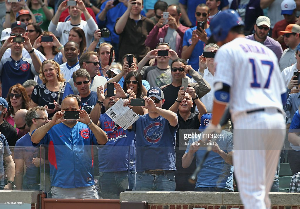 Fans take cell phone phtographs before Kris Bryant #17 of the Chicago Cubs has his first Major League at-bat against the San Diego Padres at Wrigley Field on April 17, 2015 in Chicago, Illinois.