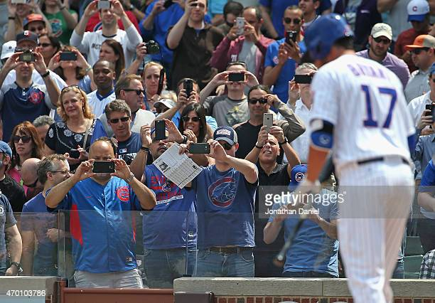 Fans take cell phone phtographs before Kris Bryant of the Chicago Cubs has his first Major League atbat against the San Diego Padres at Wrigley Field...