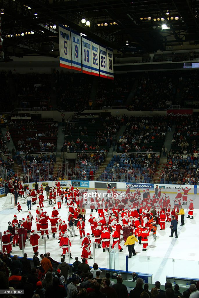 Fans take part in a Santa CLaus promotion during a New York Islander game on December 23, 2003 at the Nassau Coliseum in Uniondale, New York.