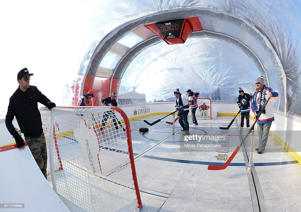 Fans take part in events at Spectator Plaza prior to the 2016 Tim Hortons NHL Heritage Classic alumni game at Investors Group Field on October 22, 2016 in Winnipeg, Canada.