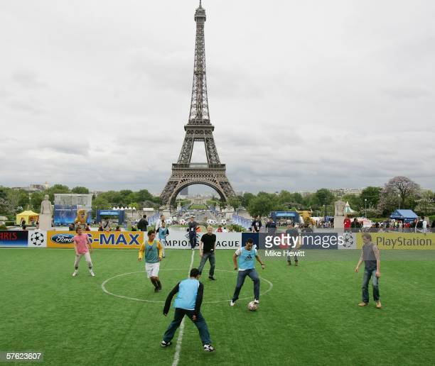 Fans take part in fiveaside football matches at UEFA's Champions Festival site by the Eiffel Tower on May 16 2006 in Paris France