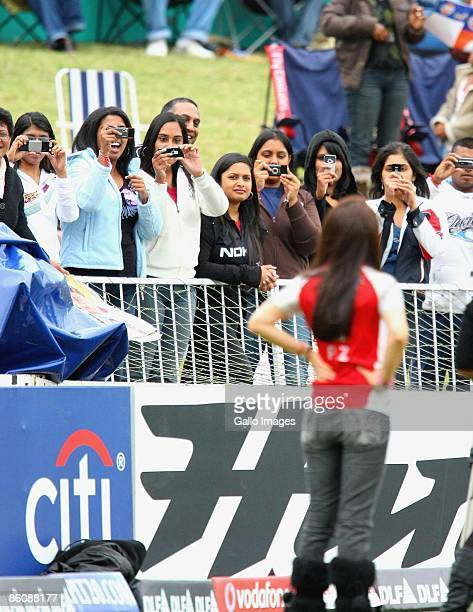 Fans take photos of Bollywood Star Preity Zinta during the IPL T20 match between Kings XI Punjab v Kolkata Knight Riders at Sahara Park on April 21...