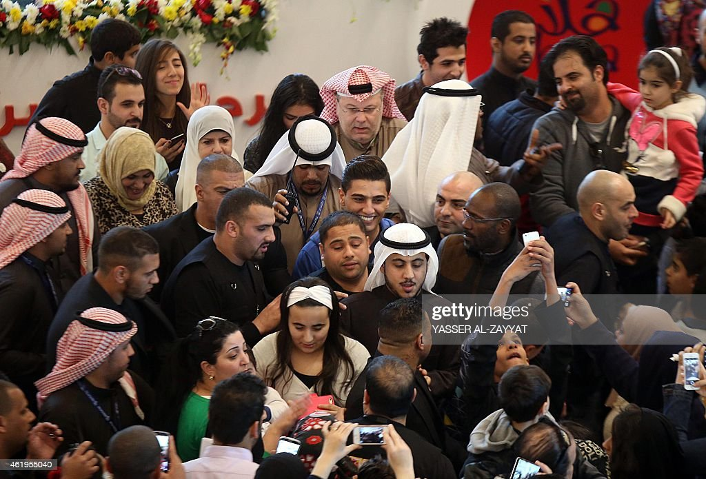 Fans take photos of Palestinian singer <a gi-track='captionPersonalityLinkClicked' href=/galleries/search?phrase=Mohammed+Assaf&family=editorial&specificpeople=10886300 ng-click='$event.stopPropagation()'>Mohammed Assaf</a> (C) at the Gate Mall in Kuwait City, one of the country's largest malls, on January 22, 2015. Assaf is in Kuwait to participate in the Hala February festival concerts.