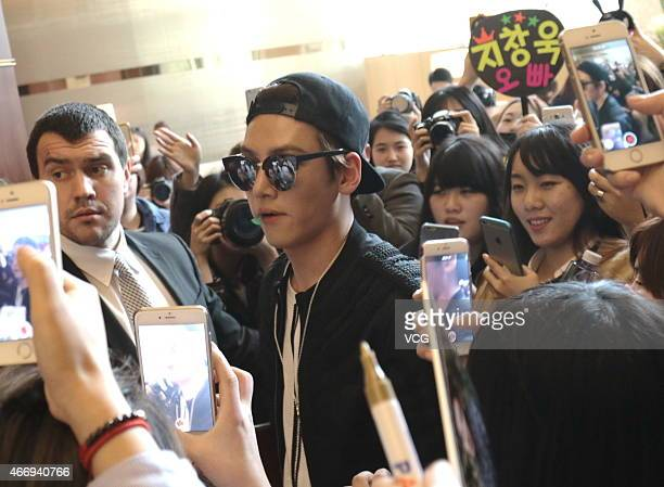 Fans take photos with their smart phones as South Korean actor Ji ChangWook arrives at hotel on March 19 2015 in Shanghai China