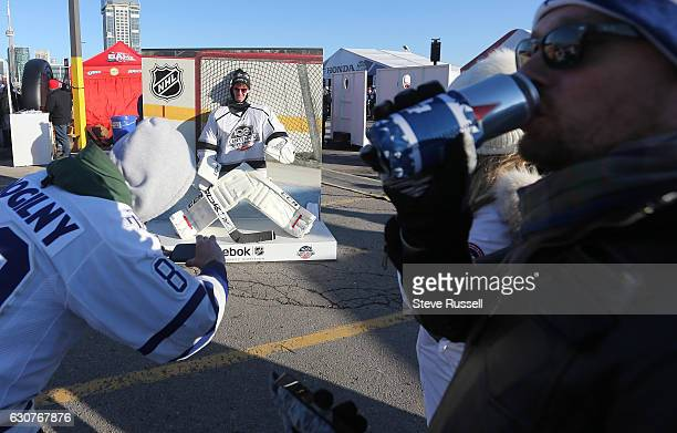 TORONTO ON JANUARY 1 Fans take pictures as the Toronto Maple Leafs play the Detroit Red Wings alumni in the Centennial Classic at Exhibition Stadium...