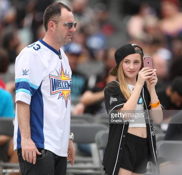 Fans take pictures during WrestleMania 33 on Sunday April 2 2017 at Camping World Stadium in Orlando Fla