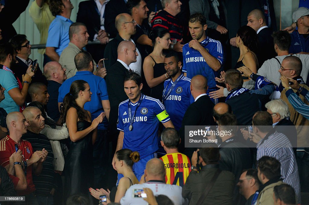 Fans take pictures of Frank Lampard, Ashley Cole and Branislav Ivanovic of Chelsea after they collected their runners up medal during the UEFA Super Cup between Bayern Muenchen and Chelsea at Stadion Eden on August 30, 2013 in Prague, Czech Republic.