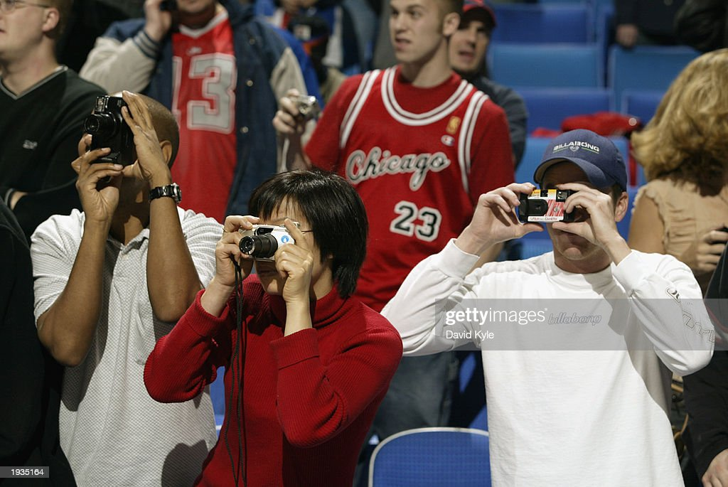 Fans take pictures of Michael Jordan #23 of the Washington Wizards during practice for his final game against the Cleveland Cavalies at the Gund Arena, on April 8, 2003 in Cleveland, Ohio. The Wizards won 100-91.
