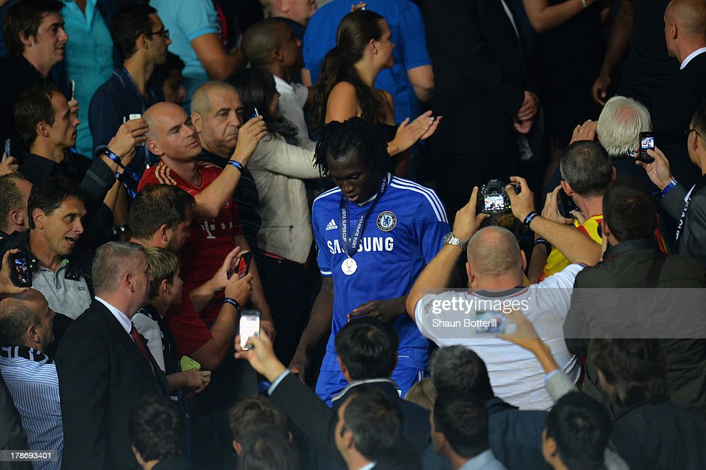 Fans take pictures of <a gi-track='captionPersonalityLinkClicked' href=/galleries/search?phrase=Romelu+Lukaku&family=editorial&specificpeople=6342802 ng-click='$event.stopPropagation()'>Romelu Lukaku</a> of Chelsea after he collected his runners up medal during the UEFA Super Cup between Bayern Muenchen and Chelsea at Stadion Eden on August 30, 2013 in Prague, Czech Republic.
