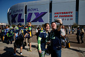 Fans take pictures outside of University of Phoenix Stadium prior to Super Bowl XLIX between the Seattle Seahawks and the New England Patriots on...