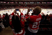Fans take pictures with their cell phones of the Chicago Blackhawks warming up prior to Game Five of the Western Conference Final against the Los...