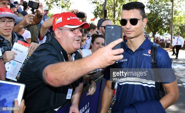 Fans take selfies with Sauber's German driver Pascal Wehrlein in Melbourne on March 24 ahead of the first practice sessions at theFormula One...