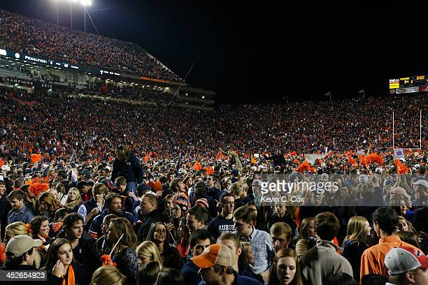 Fans take the field to celebrate with the Auburn Tigers after they defeated the Alabama Crimson Tide 34 to 28 at JordanHare Stadium on November 30...