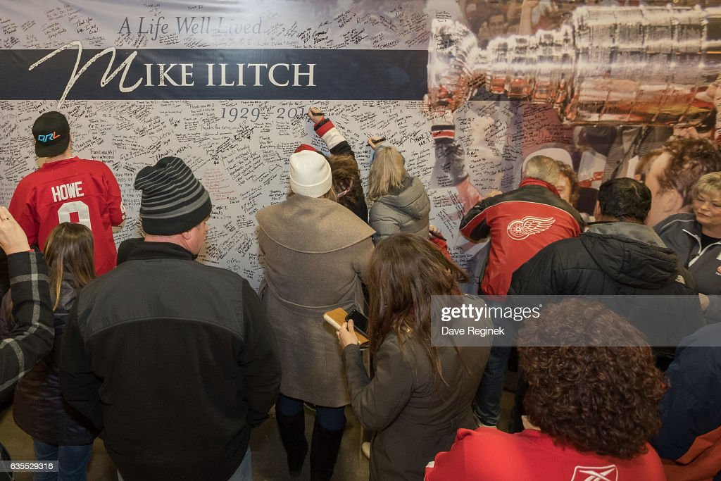 Fans take the time to sign a farewell tribute to Detroit Red Wings owner Mike Ilitch who passed away February 10, 2017 prior to an NHL game between the Detroit Red Wings and the St. Louis Blues at Joe Louis Arena on February 15, 2017 in Detroit, Michigan.