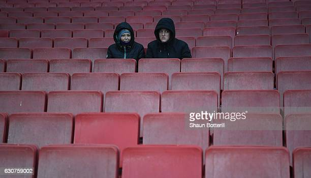 Fans take their seats before the Premier League match between Arsenal and Crystal Palace at Emirates Stadium on January 1 2017 in London England