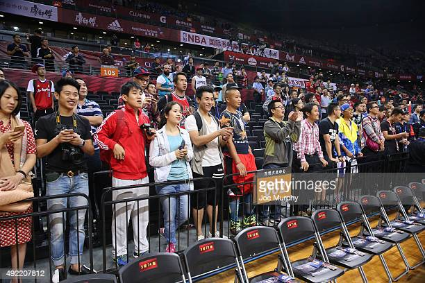 Fans takes in the game of the Los Angeles Clippers against the Charlotte Hornets as part of the 2015 NBA Global Games China at the Shenzhen...