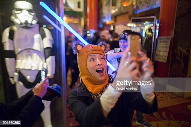 Fans takes sefies near a storm trooper display at a screening on opening night of Walt Disney Pictures And Lucasfilm's 'Star Wars The Force Awakens'...