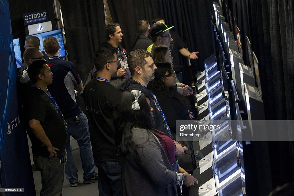 Fans test out the Sony PlayStation 4 console during its midnight launch event in San Francisco, California, U.S., on Thursday, Nov. 14, 2013. Sony Corp., poised to release the PlayStation 4 game console this week, is confident it can meet analysts' sales estimates of 3 million units by year-end, exploiting an early advantage over Microsoft Corp.'s Xbox One. Photographer: Erin Lubin/Bloomberg via Getty Images