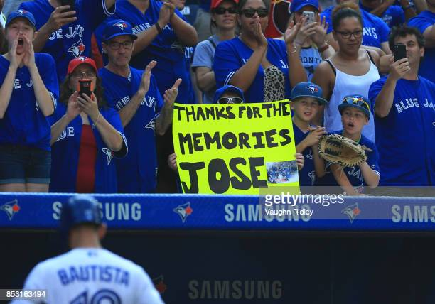 Fans thank Jose Bautista of the Toronto Blue Jays after he pops out at his final at bat this season in the eighth inning during MLB game action...