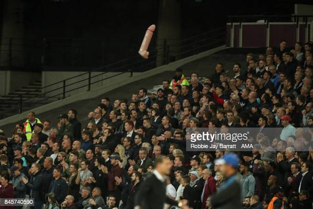 Fans throw around an inflatable penis during the Premier League match between West Ham United and Huddersfield Town at London Stadium on September 11...