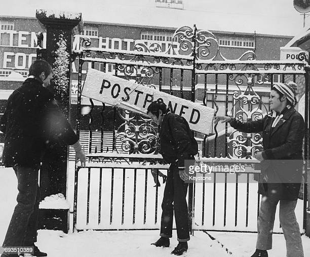 Fans throwing snowballs outside the gates of Tottenham Hotspur's White Hart Lane ground where a match has been postponed due to the snowy weather...