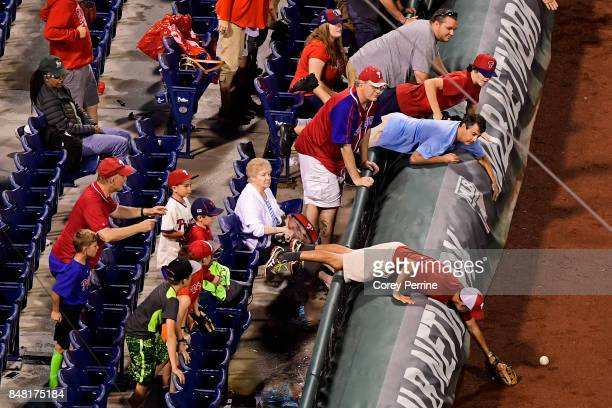 Fans track down a foul ball on the third base side as the Philadelphia Phillies host the Oakland Athletics during the eighth inning at Citizens Bank...