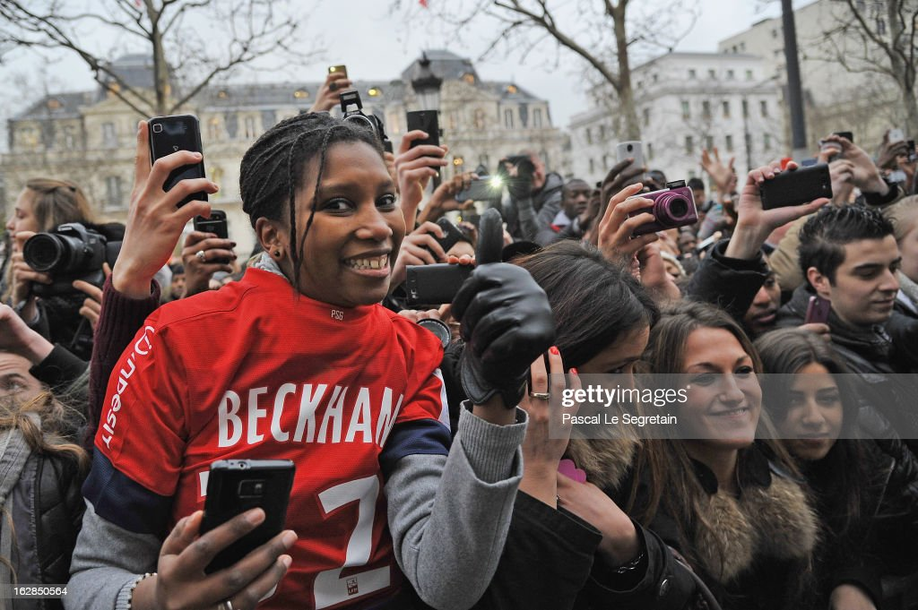 Fans try to get a glance at David Beckham attending an autograph session at adidas Performance Store Champs-Elysees on February 28, 2013 in Paris, France.